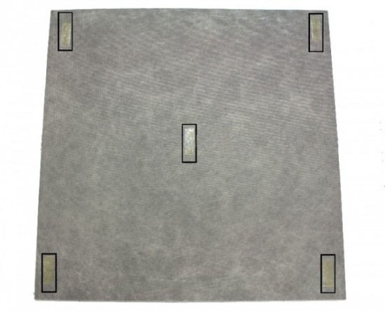 Here, you can see how adhesive strips are easily applied to the anchor points of a carpet tile.